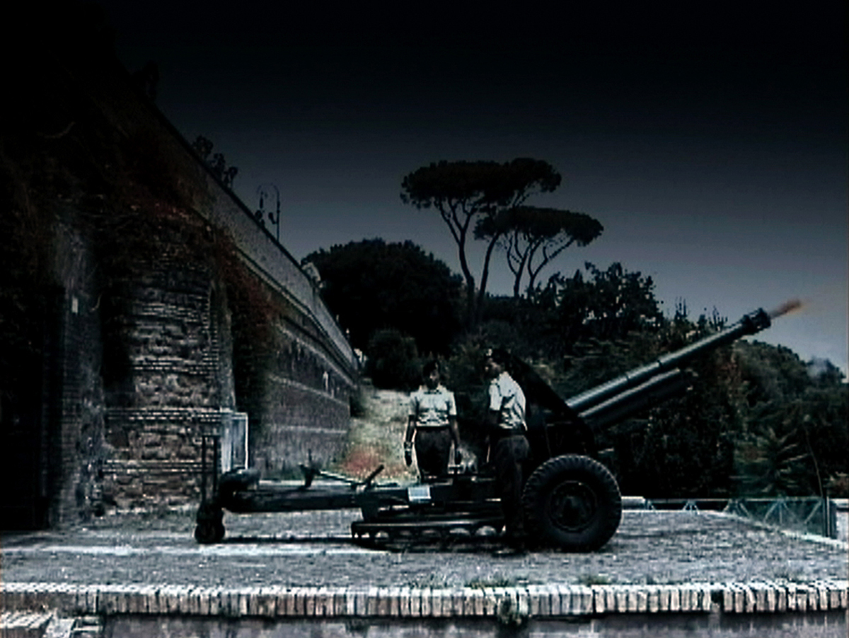 "Noon, 2002 Videotape DV-CAM PAL colour sound, transferred on DVD 6' 10"" Every day in Rome at noon a squad of artillerymen load and fire a cannon."